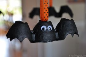 An egg carton bat with goggly eyes. So much cuter than a real bat. I think the orange and black ribbon is a really cute touch. :) Jodi from the Clutter-Free Classroom: