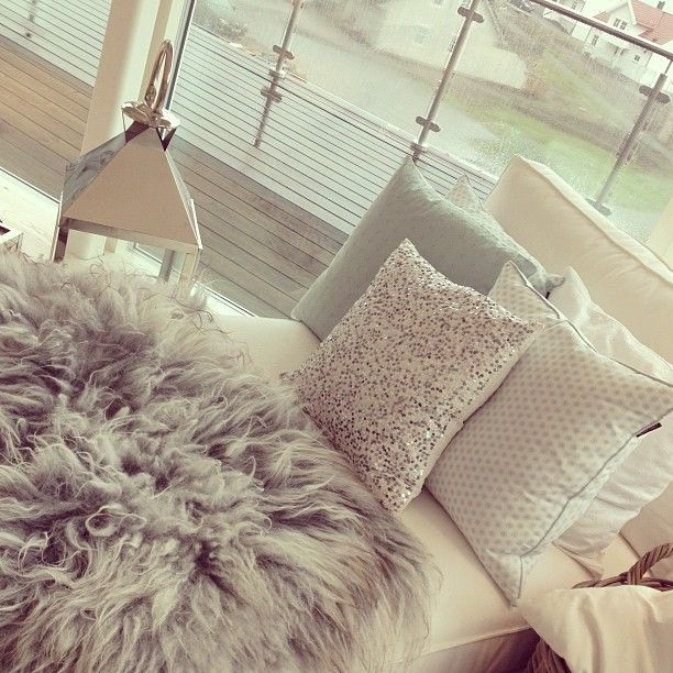 Room design. so cute. love the fur rug and the glittered pillow. will have it somewhere