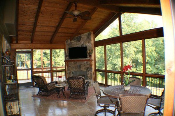 Porch With A Fireplace And Tv