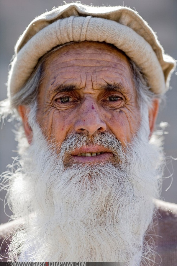 Elderly Pakistani Man With White Beard And Typical Hat