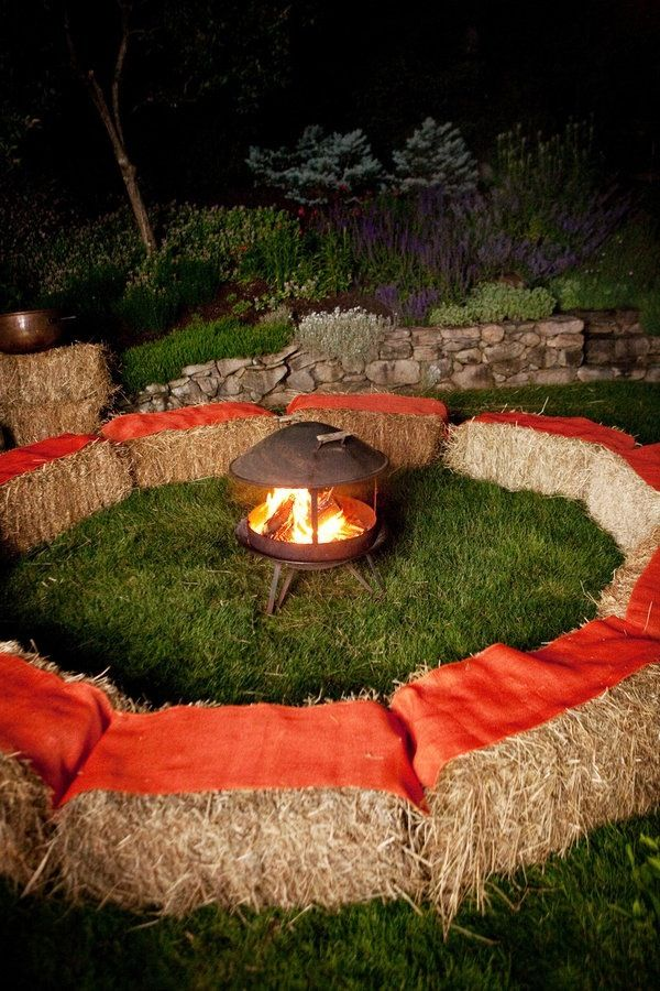 Create a cozy campfire setting using hay bales and