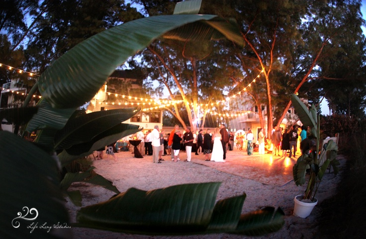 A Beach Wedding With String Lighting On Sunset Beach In