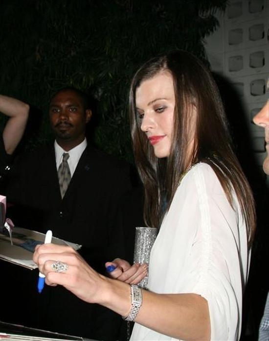 Milla Jovovich Wears Cartier Tank Americaine Diamond Watch
