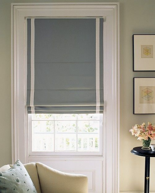 colored roman shade with white embellishment.  time to get serious about some window coverings.