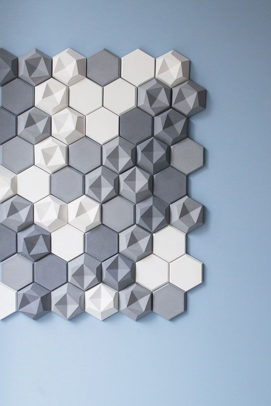 The six-sided figures provoke each other: While the three-dimensional hexagons stand out due to their asymmetrical surfaces, the two-and-half-dimensional form provides a calming contrast.: