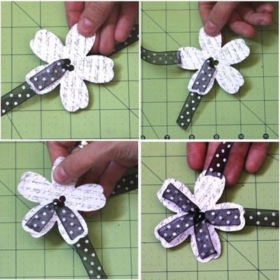 Ribbon flower embellishment. so gonna make this.. actually I will make tons of these. Great for gift tags, string them instead of