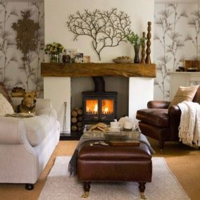I usually think woodstoves are practical, not beautiful. But, I love the way this gorgeous room comes around the stove.