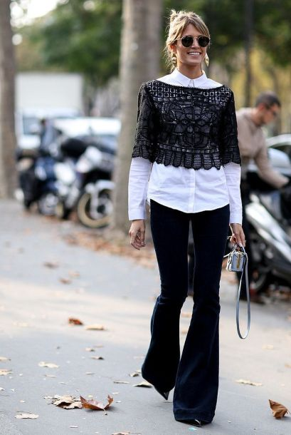 Interesting layering: white shirt + crochet top + flares--Paris Fashion Week Spring Summer 2015 Street Style