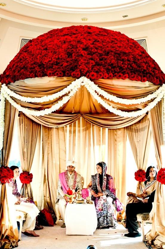 round mandap, red Flowered Mandap, indian wedding decor