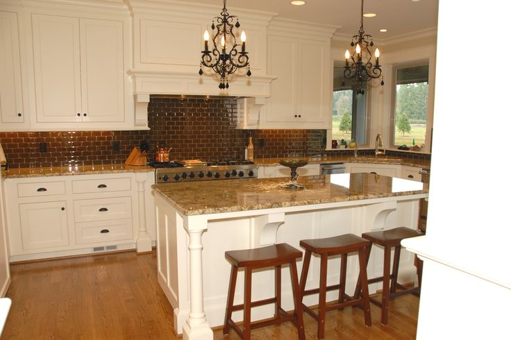 Traditional White Kitchen Cabinets With A Large Island