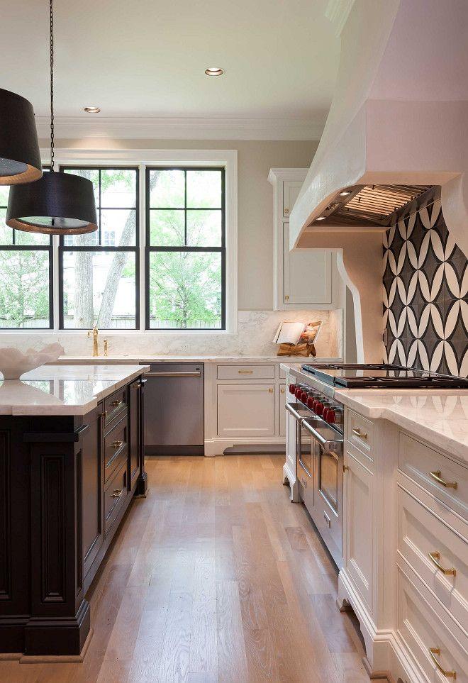 White kitchen with dark island, cement tile backsplash and