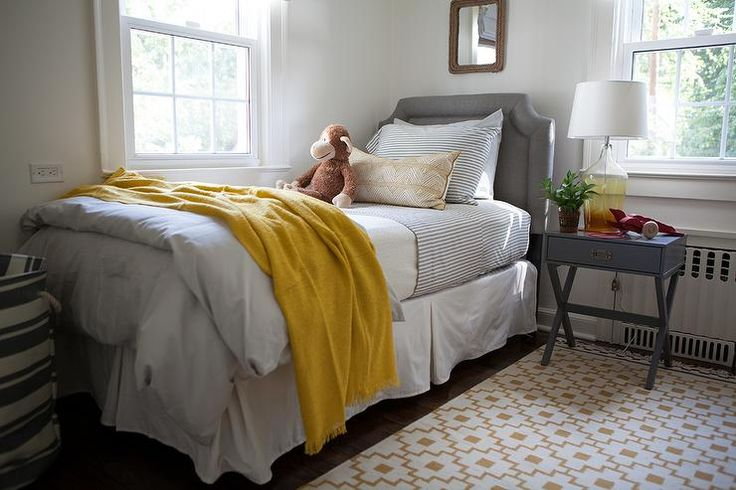 Yellow And Gray Boy's Room Boasts A Rope Mirror Over A