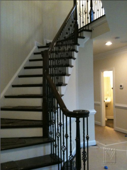 Wrought Iron Baluster In A Pewter Color With Wood Handle