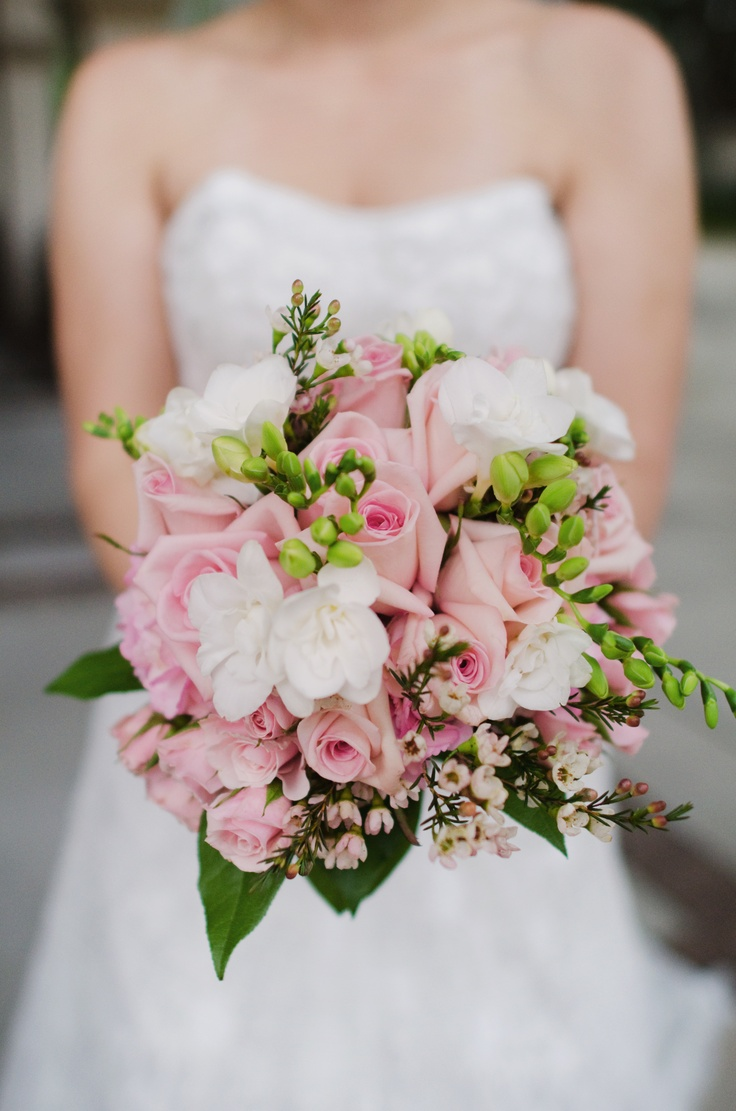 bouquet of pink roses, white freesia, pink wax