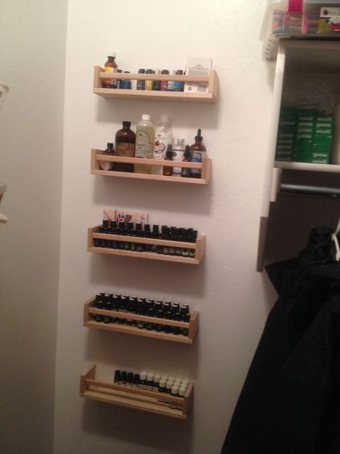 IKEA Bekvam spice racks ($3.99 each) for essential oil storage.  These are placed behind a closet door to use otherwise wasted space.: