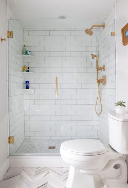 Bathroom Bliss. Master Bath walk-in shower with rose gold fixtures and hardware.:
