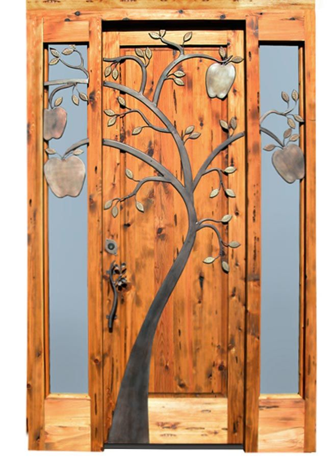 Detail of the tree on the door and how it carries on to the windows.