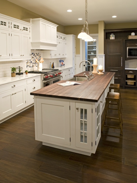 White Kitchen With Stained Butcher Block Island Design. I