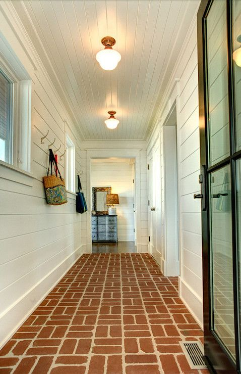 Stunning Mudroom Features A Black Glass Door Opening To