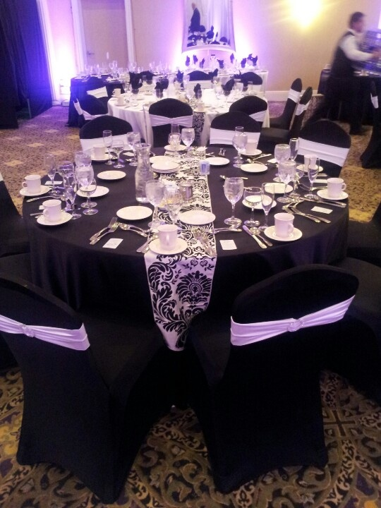 Black Spandex Chair Cover With White Band And Broach And
