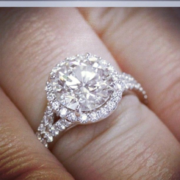 Halo Engagement Ring With Round Cut Center Stone And