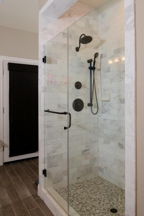 This Glass Enclosed Shower Features Beautiful Carrara