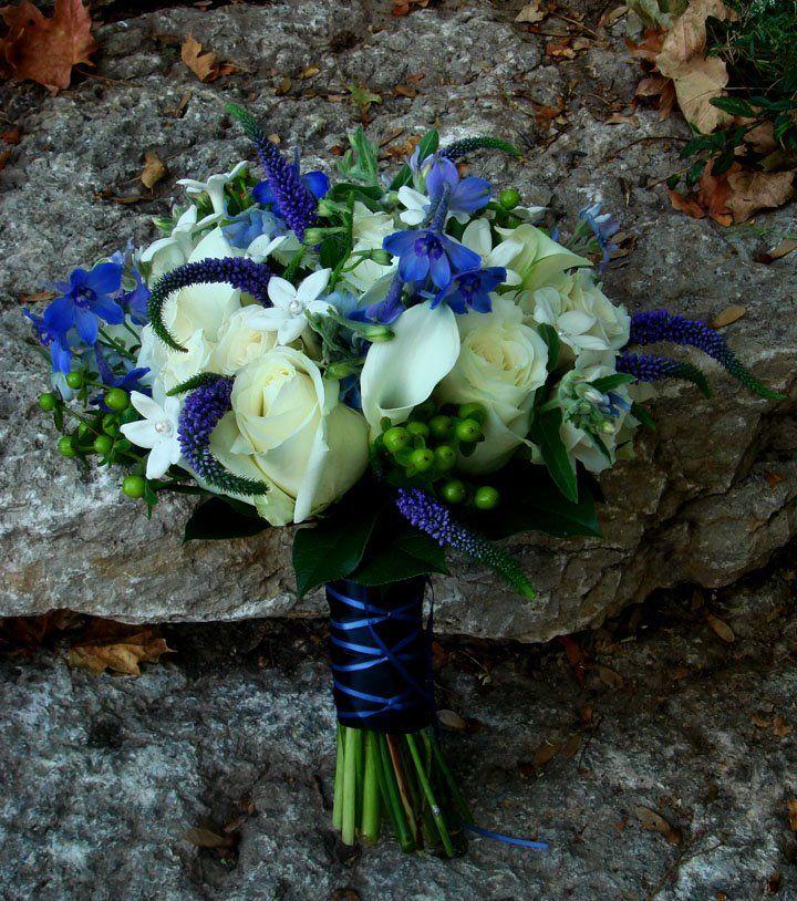 White rose, stephanotis, calla bouquet with blue