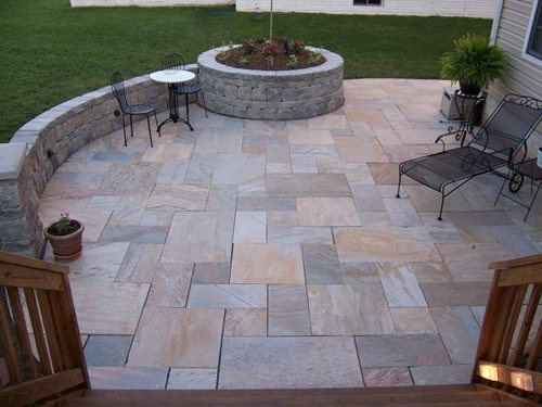 Geometric Random Stone Patio With Curved Wall Bench And