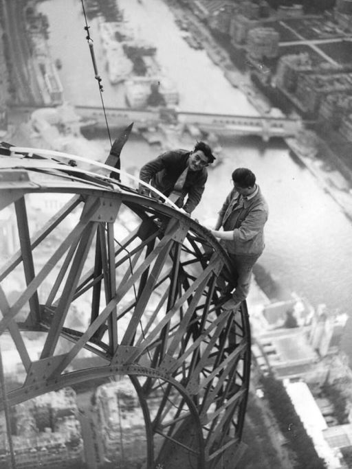 <> Electricians working on the Eiffel Tower, Paris, in 1937.: