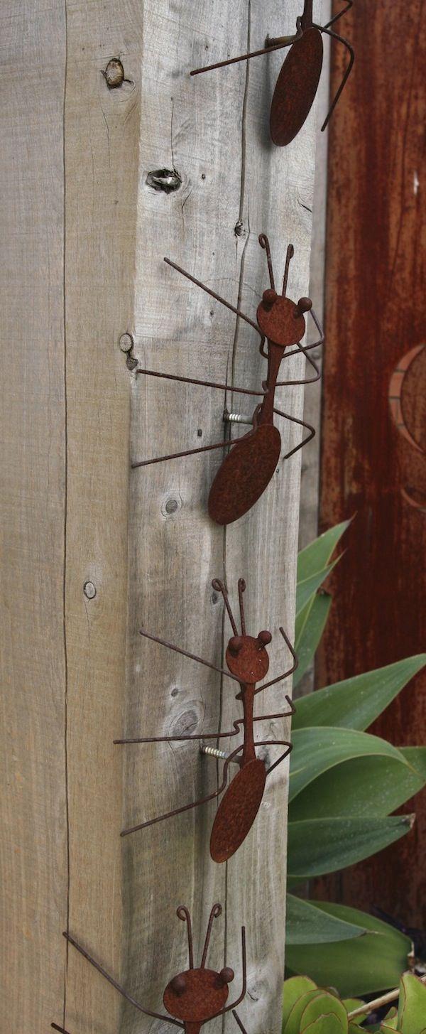 Decorative rusting steel bullants climb the hardwood pergola post. Steven Wells garden at Royal Talbot Reh