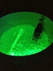 Adding a glow stick to serve drinks- great idea for backyard entertaining!