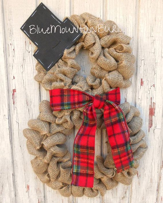 The Snowman Burlap Wreath accented with a beautiful red tartan plaid scarf and a wooden tophat! The perfect addition to your home