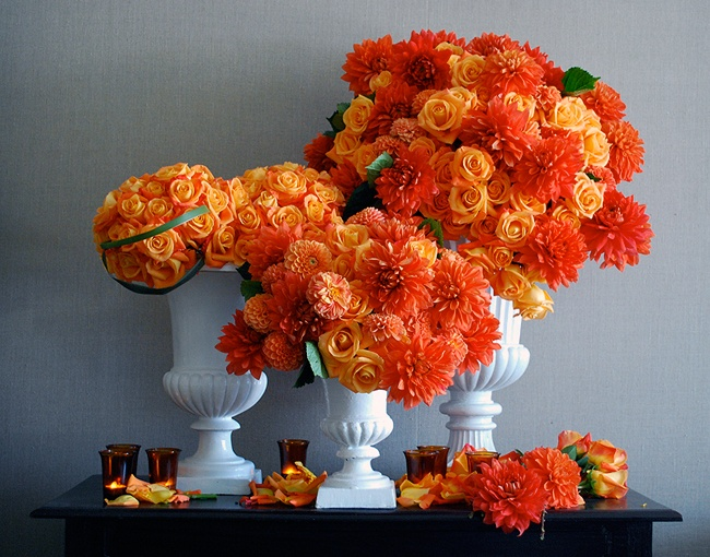 Brilliant Orange Flower Arrangements In Complementary Blue