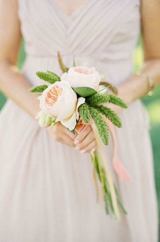 A simple and romantic wedding bouquet compliments the delicate dusty rose colored bridesmaid dress.