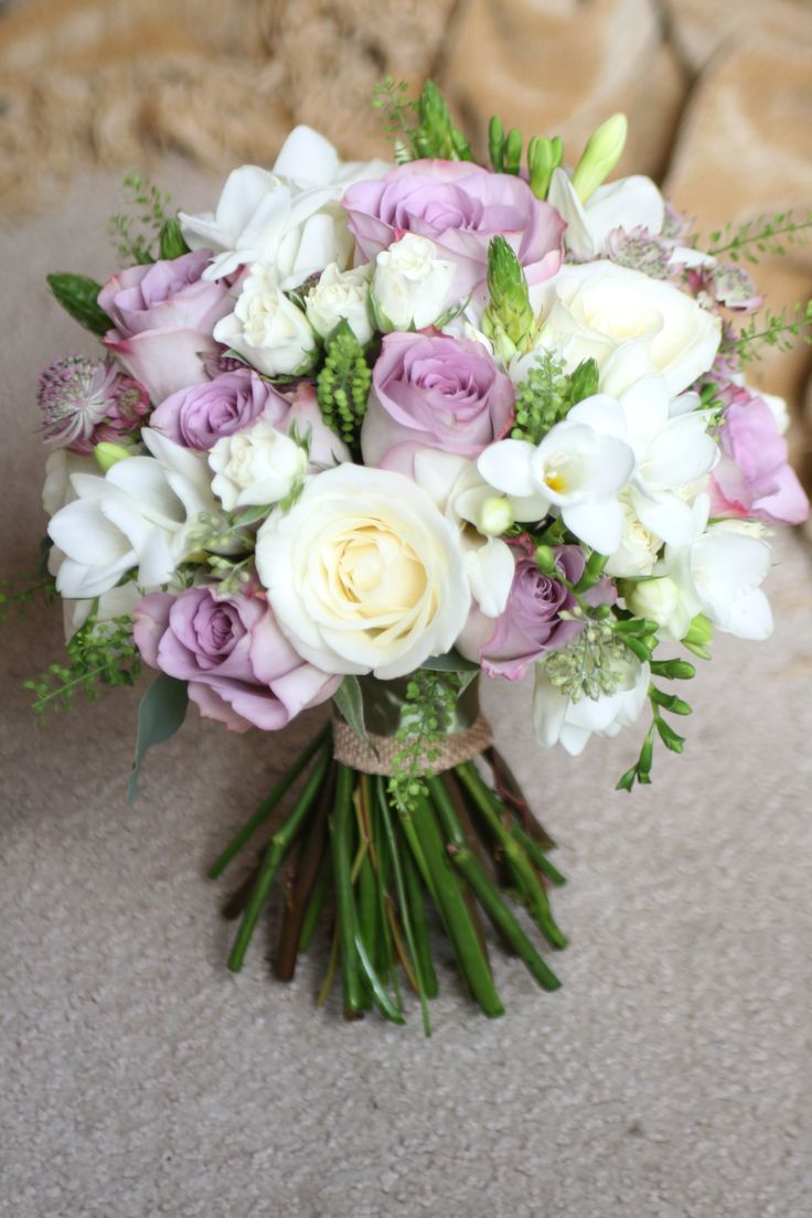 Vintage style bouquet with roses, freesia, spray roses