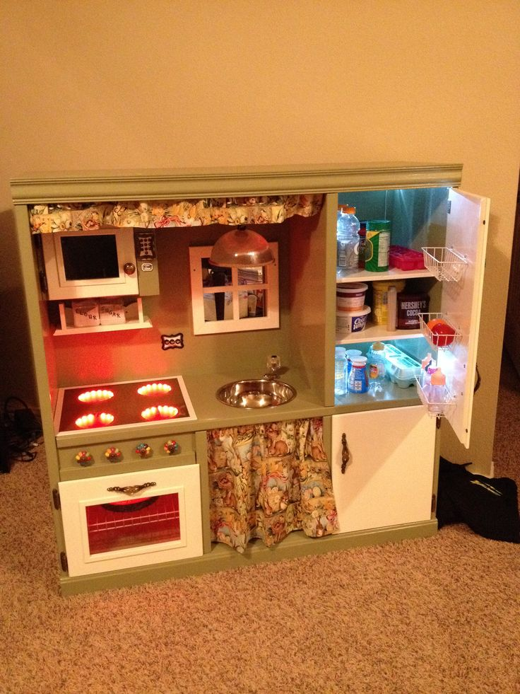 Play kitchen made from used entertainment center ️ Kids