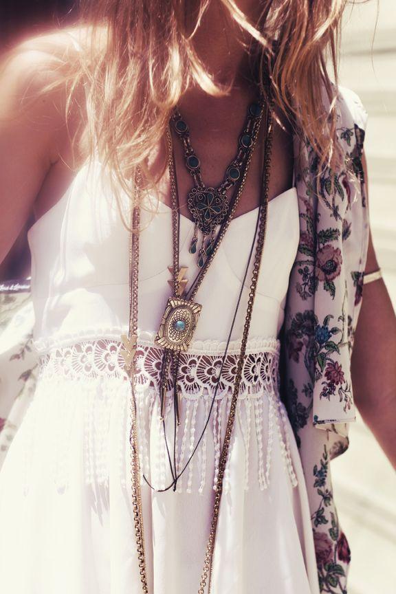 Feminine boho lace fringe dress with modern hippie fashion layered necklaces for