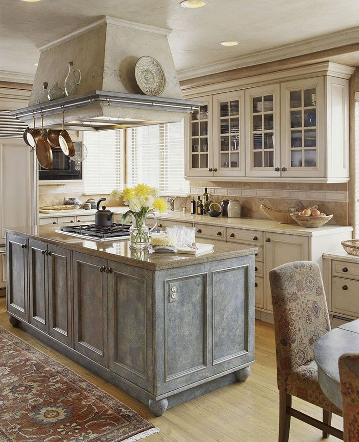 A Europeaninspired kitchen gets its rich texture from an