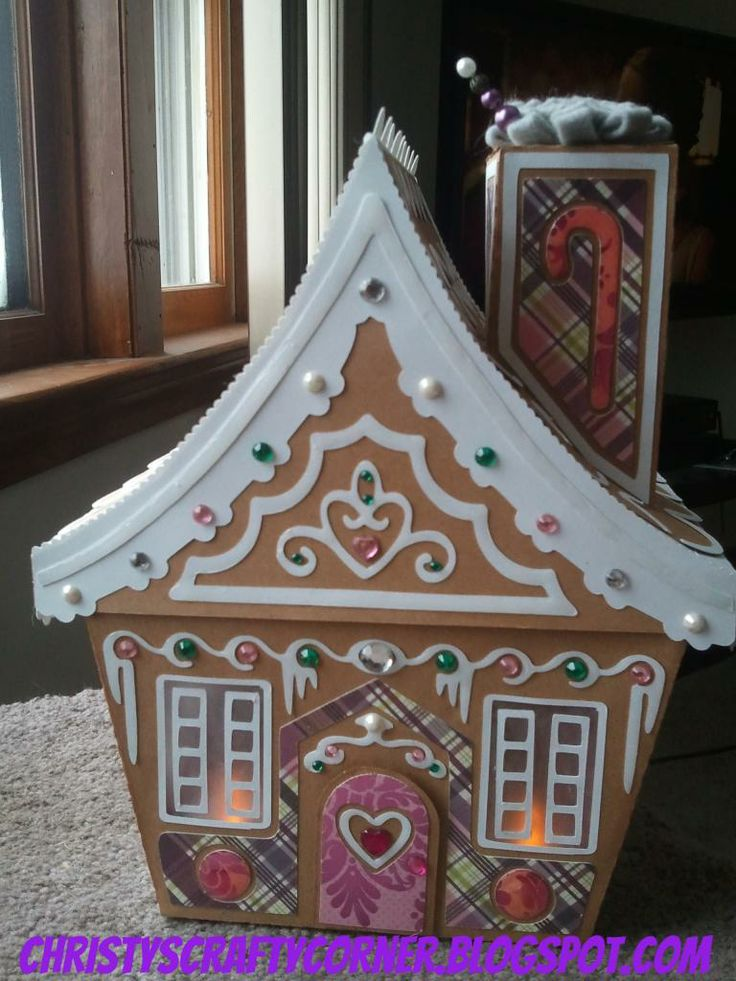 How sweet it is! This adorable Gingerbread House is a box