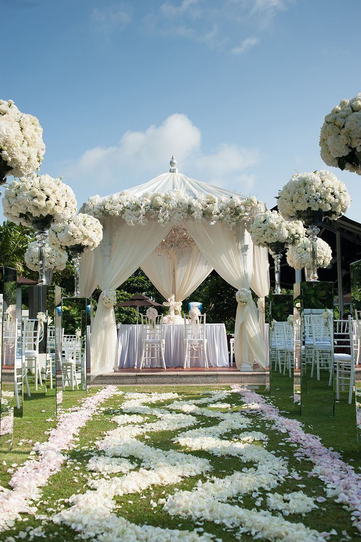 Wedding gazebo decorated with white and pink flowers