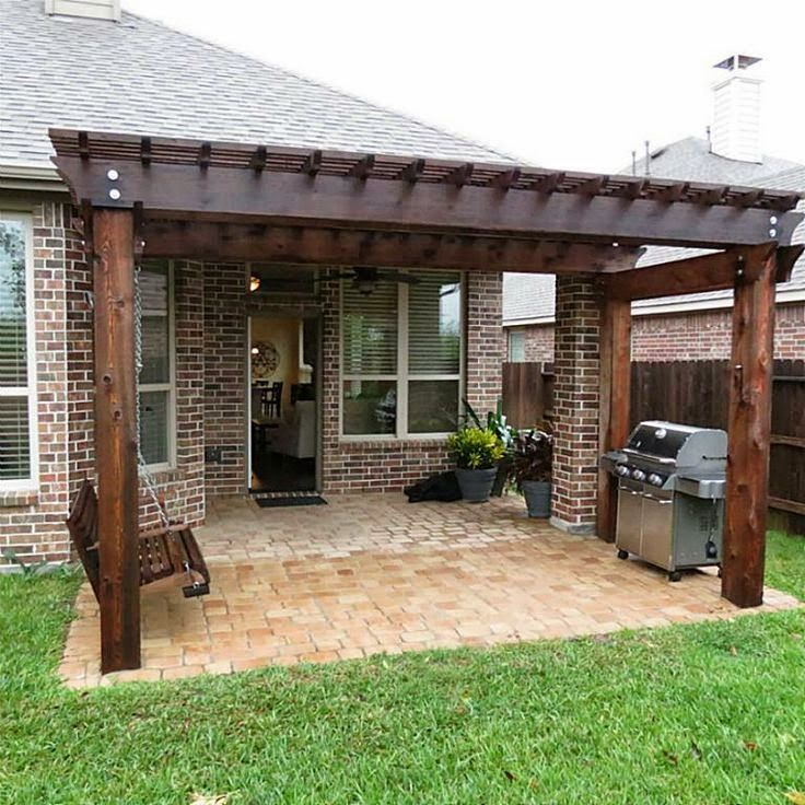 Pergola off of an existing covered porch IN THE GARDEN