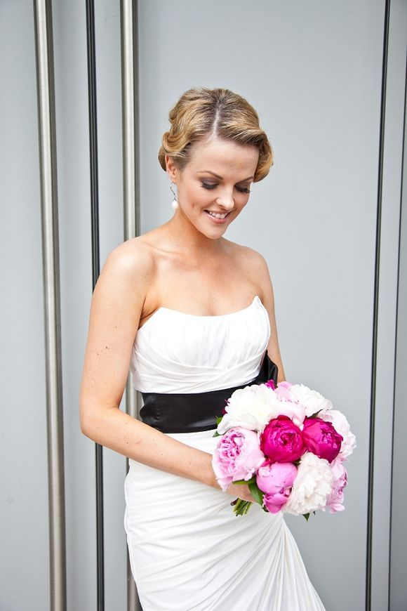 Black  White wedding dress, with a Pink flower bouquet. Gorgeous!  Would swap th