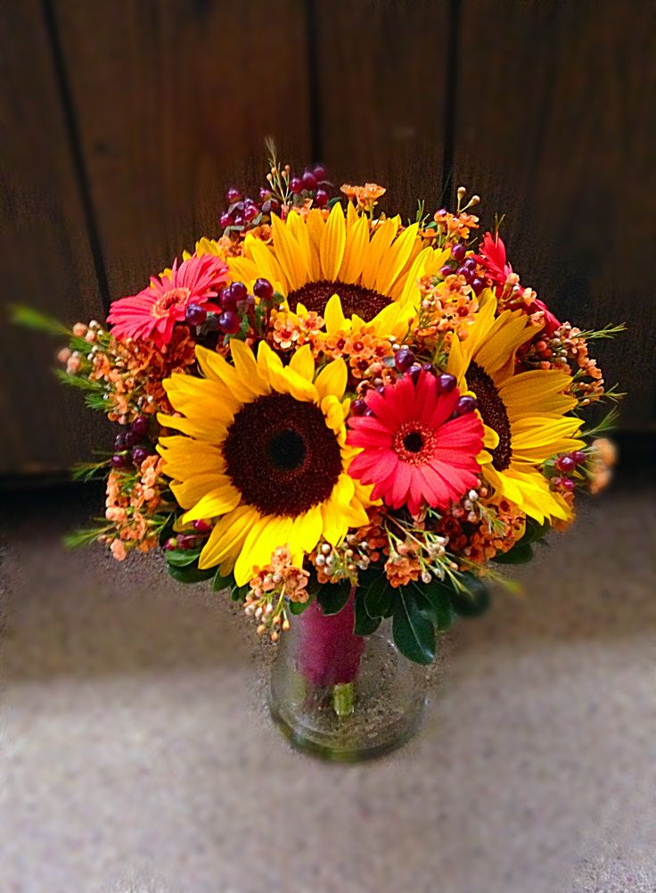 Fall bridal bouquet with sunflowers, gerber daisies, wax