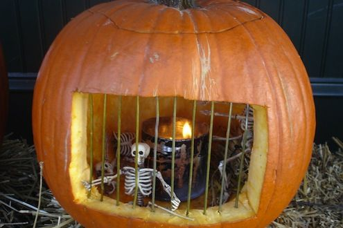 Pumpkin Jail Cut oblong hole Insert bamboo squewers (painted grey) Put small skeletons and tin with night light in….  Light it