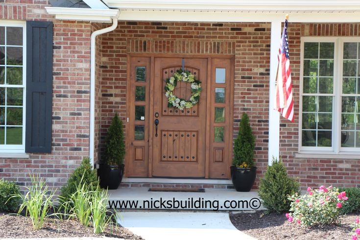 The Great American Entrance Red Brick House With Tan Door