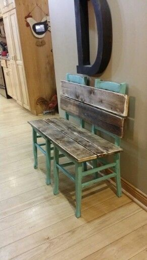 Rustic bench painted and distressed in aqua. Made from old chairs.