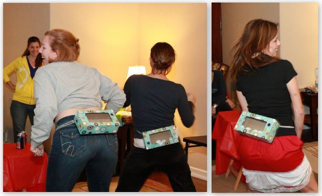 Junk in the Trunk Game!    (Attach an empty rectangle tissue box around the waist and fill it with 8 ping pong balls.  Contestant must shake their rump to get all the balls out in 60 seconds.  (Note:
