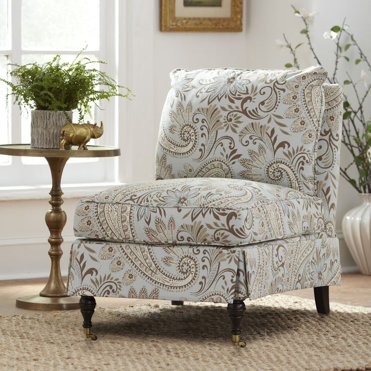 Kendall Slipper Chair With an armless profile and