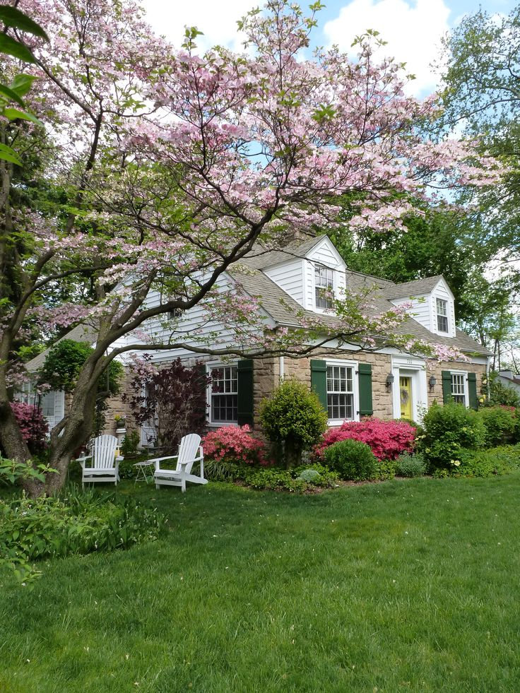 Cottage in Spring. My perfect home. Dormers, stone, green