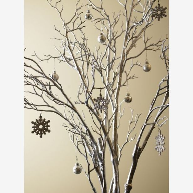 Spray paint branches and hang some colored ornaments or plain ones, looks great!!: